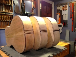 Three guitar bodies from the back